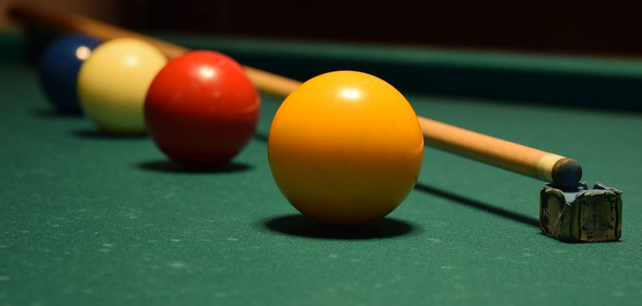 billiards table cue and balls