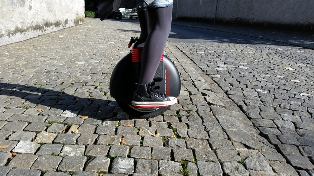 electric unicycle on bricks