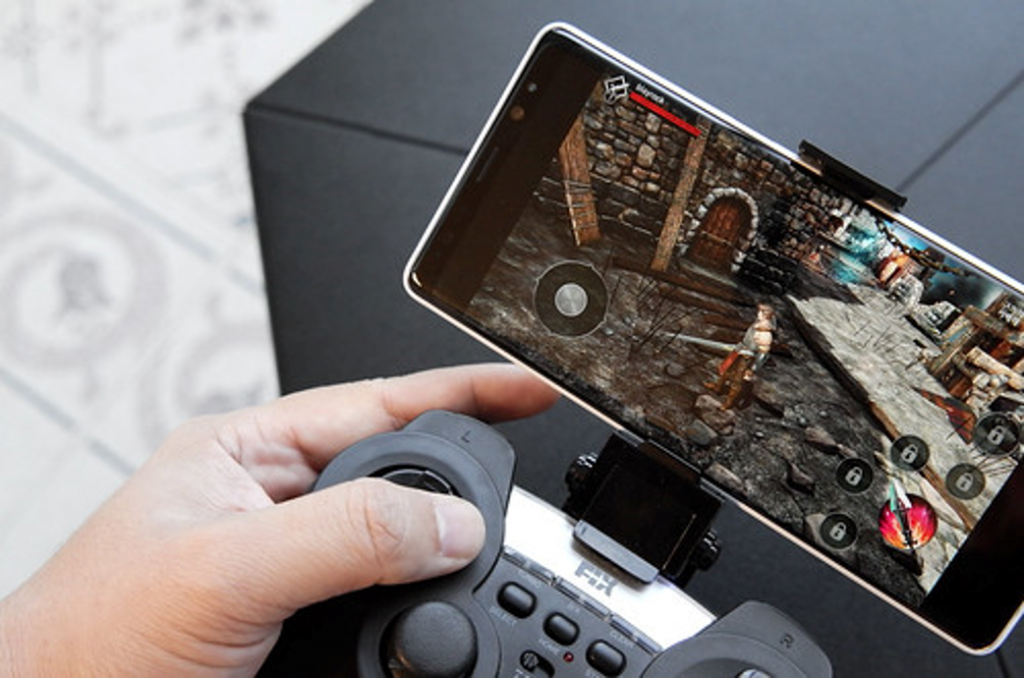 playing a mobile game with a controller